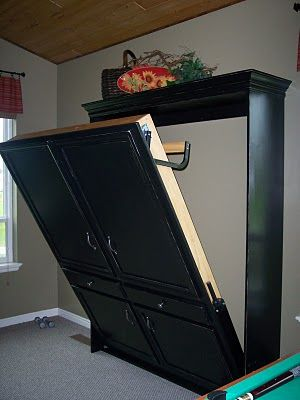 DIY murphy bed - made to look like armoire. Guest room/office? LOVE this