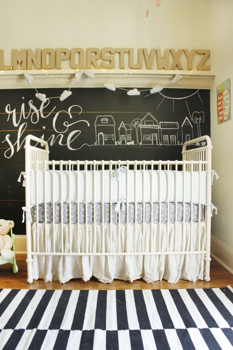 Black and white rug paired with a chalkboard wall - nursery LOVE!