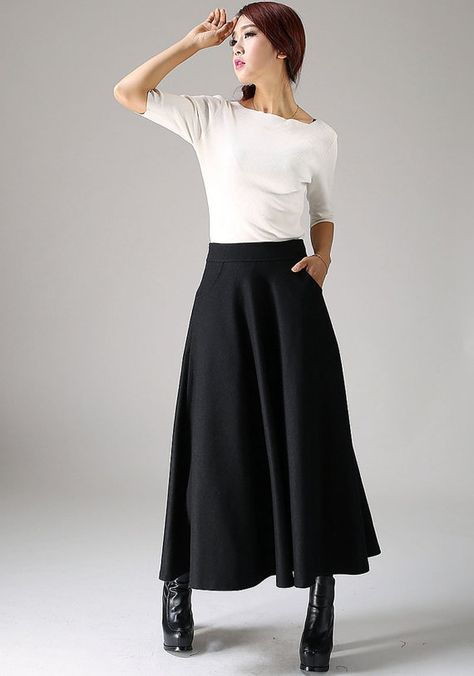 Zwarte wol rok maxi rok vrouwen rok (1088). Eerbare kleding. Eng. Modest clothing. Fr. Vêtement modeste. Du. Bescheidene Kleidung. Sp. ropa modesta.