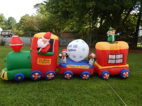 St Nick Express Train Christmas Inflatable.  This one fun bunch of guys celebrating the Holiday Season.