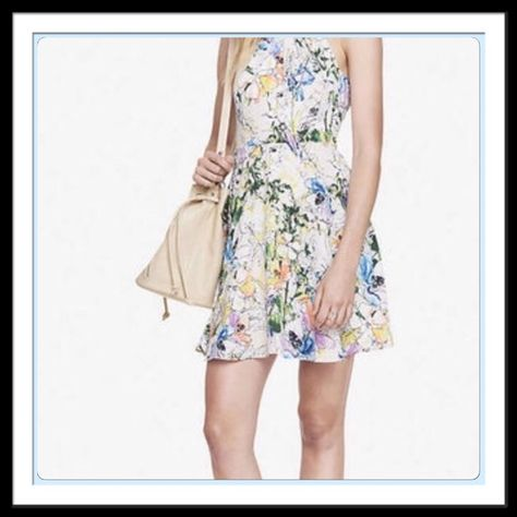 NWT EXPRESS Floral Dress NWT EXPRESS Dress. Gorgeous Floral pattern with an open back. Neon pinks, yellow, and blues, greens. Perfect for spring. Please ask all questions before purchasing. ✅ Accepting reasonable offers  No trades No offline transactions  Thanks for stopping by.  Express Dresses