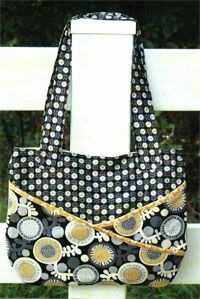 """Dina Bag Pattern by Abbey Lane Quilts at KayeWood.com. THE """"DINA"""" BAG is a great new bag. The cross fabrics on the outside are really pockets. They are on both sides of the bag. Great for keeping your keys or phone, things you need to get to fast. The inside also has big roomy pockets to keep everything organized. http://www.kayewood.com/item/Dina_Bag_Pattern/3815 $10.00"""