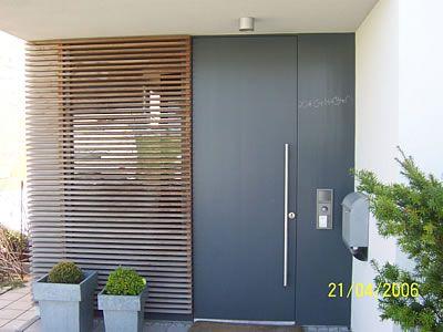 Eingangstüren holz glas  Eleganter Eingangsbereich mit bodentiefen Fenstern | Casas ...
