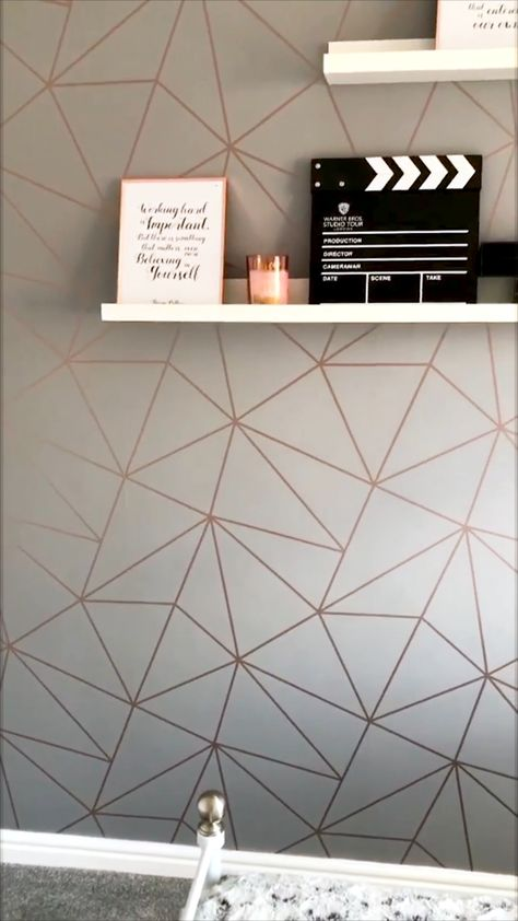 The Zara Shimmer Metallic Wallpaper in Charcoal & Copper by I Love Wallpaper.  A Beautiful and Unique Geometric Design that enhances luxury and sophistication.  For more designs visit ilovewallpaper.co.uk #ilovewallpaper #interiordesign #homedecor