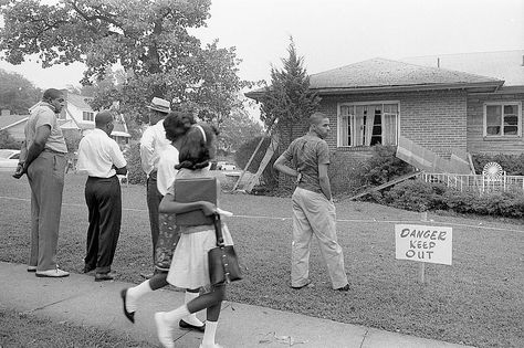 Group of African Americans viewing the bomb-damaged home of Arthur Shores…