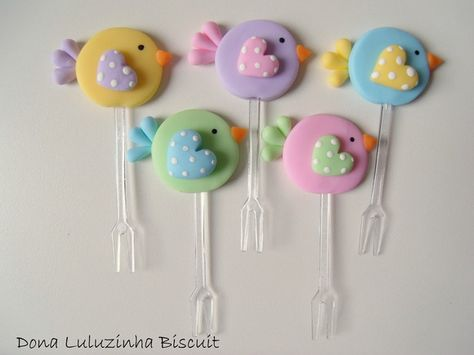 Fimo bird decorated appetizer fork.