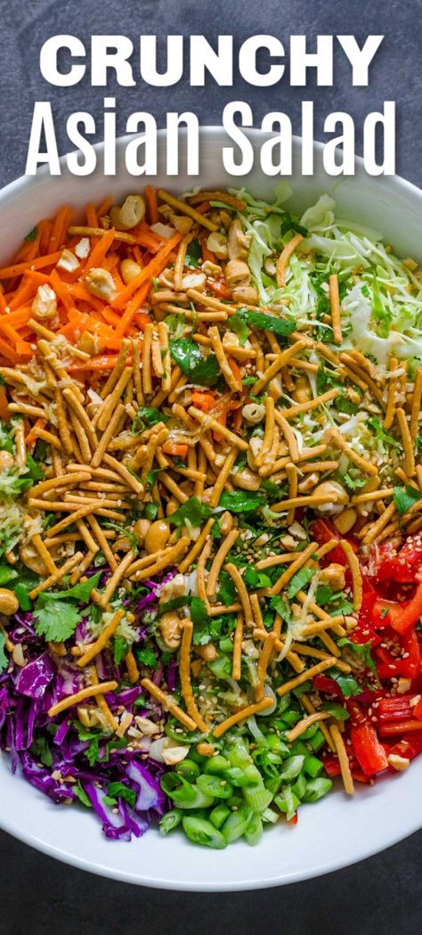 Crunchy Asian Chopped Salad with cabbage, carrots, bell pepper, snap peas, crunchy chow mein noodles and cashews. The homemade Asian Salad dressing is irresistibly good. This is a family favorite and everything about this side dish is good. #asiansalad #choppedsalad #crunchy #asianchoppedsalad #easysalad #salad