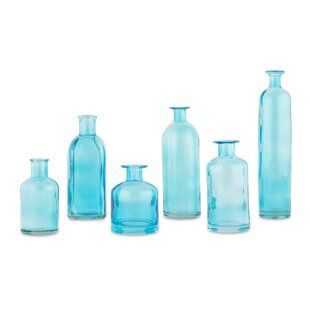 Pin By Jeannie Bains On Home Decor Colored Glass Bottles Table Vases Glass Bottles