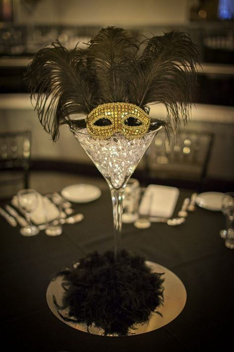 Masquerade Centrepiece (martini glass) for hire. Includes martini glass, crystals, feathers, glass bottom & various masks. Perfect for masquerade parties Masquerade Party Centerpieces, Masquerade Party Decorations, Masquerade Ball Party, Sweet 16 Masquerade, Mardi Gras Centerpieces, Masquerade Wedding, Masquerade Theme, Mardi Gras Decorations, Balloon Centerpieces
