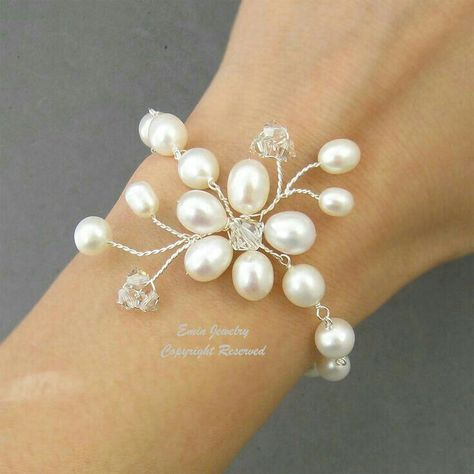 Wire wrapped pearls bracelet. Delicate pearls turned into flowers make this bracelet perfect for weddings or bridesmaid
