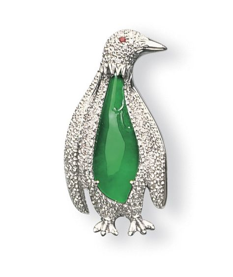 A JADEITE AND DIAMOND PENGUIN PENDANT/BROOCH    Designed as a pavé-set diamond penguin enhanced with a carved jadeite cabochon of icy vivid emerald green material, to a ruby-set eye, mounted in 18k white gold