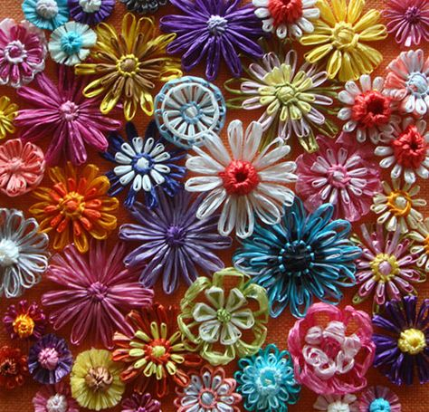 Get some flower looms and use those piddly plastic store bags that are useless but have nice colors.