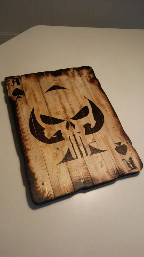I had someone come to me and ask if I could make them a Punisher Skull on an Ace of Spades card. So I was up for the challenge. I used my Ryobi biscuit joiner and joined a couple of boards together, I cut it out in a worn card looking shape, then drew my design and hand burned/torched it. The guy was very pleased, and now has me making more for friends. :)