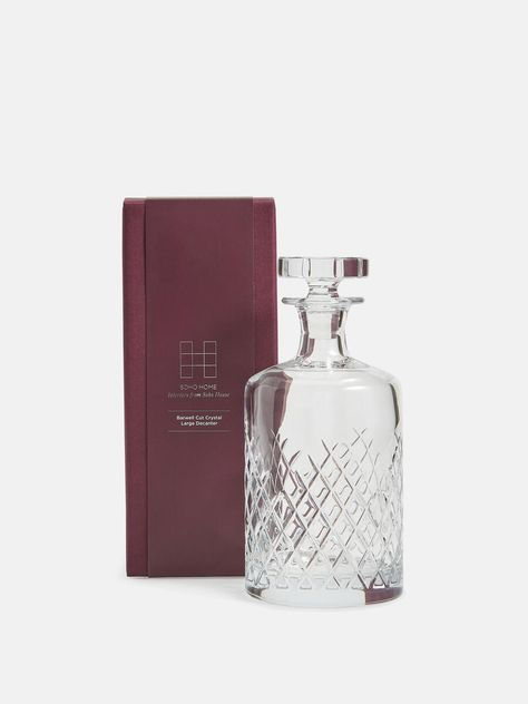 Large cut crystal decanter with matching stopper. 750ml capacity. Crystal has a weighty feel and a highly polished brilliance. Each piece is hand finished. Perfect for storing spirits on a bar cart or in a drinks cabinet. Our Barwell cut crystal is used in all our Houses Dimensions Total Width: 10cm Total Height: 21cm. Soho Home Barwell Decanter Boxed | Large