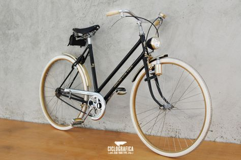 """This Ciclografica bike is built around the theme, """"Love comes, love goes."""" It looks better on the frame printed in Italian with gold Art Deco script."""
