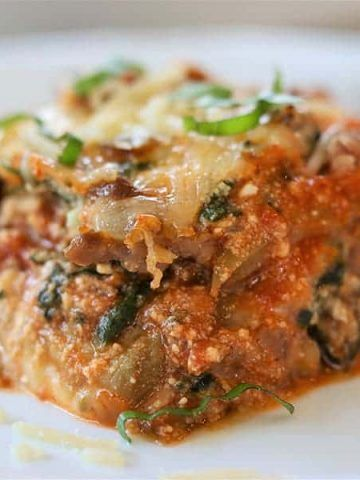 Eggplant lasagna is so delicious and healthy. This lasagna recipe uses roasted eggplant instead of pasta but has all your favorite flavors from a traditional lasagna! Roasted eggplant gives lasagna casserole loads of flavor. Lasagna recipe with ricotta and eggplant a healthy recipe. A low carb and keto lasagna recipe that everyone will love. #eggplant #lasagna #eggplantrecipe #lasagnarecipe #ketolasagna #lowcarb #ketogenic #eggplantlasagna #healthyrecipe #eggplantrecipehealthy