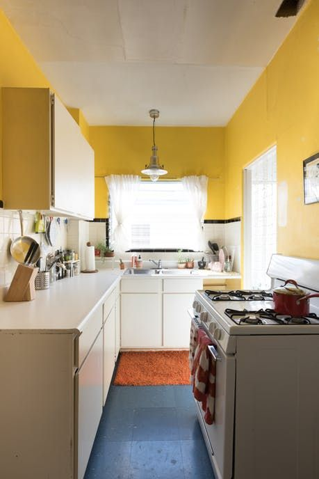 Modest Kitchen With Yellow Painted Walls In 2020 Yellow Kitchen Interior Yellow Kitchen Designs Kitchen Design Color