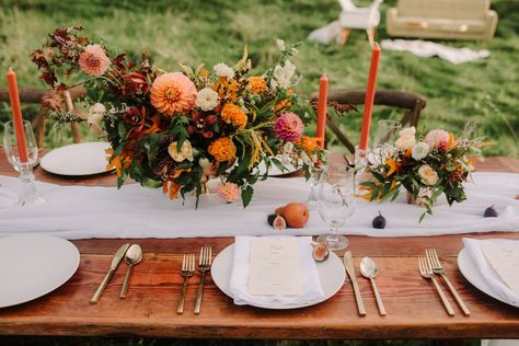 boho wedding centerpieces by Blooms by Brandi; flowers used include dalihas, ranunculas, garden roses, fall leaves, and orchids; Photographer: Twig & Olive Photography #Autumnwedding #bohowedding #dalihas #fall #warmtoned #jeweltones #BloomsbyBrandi