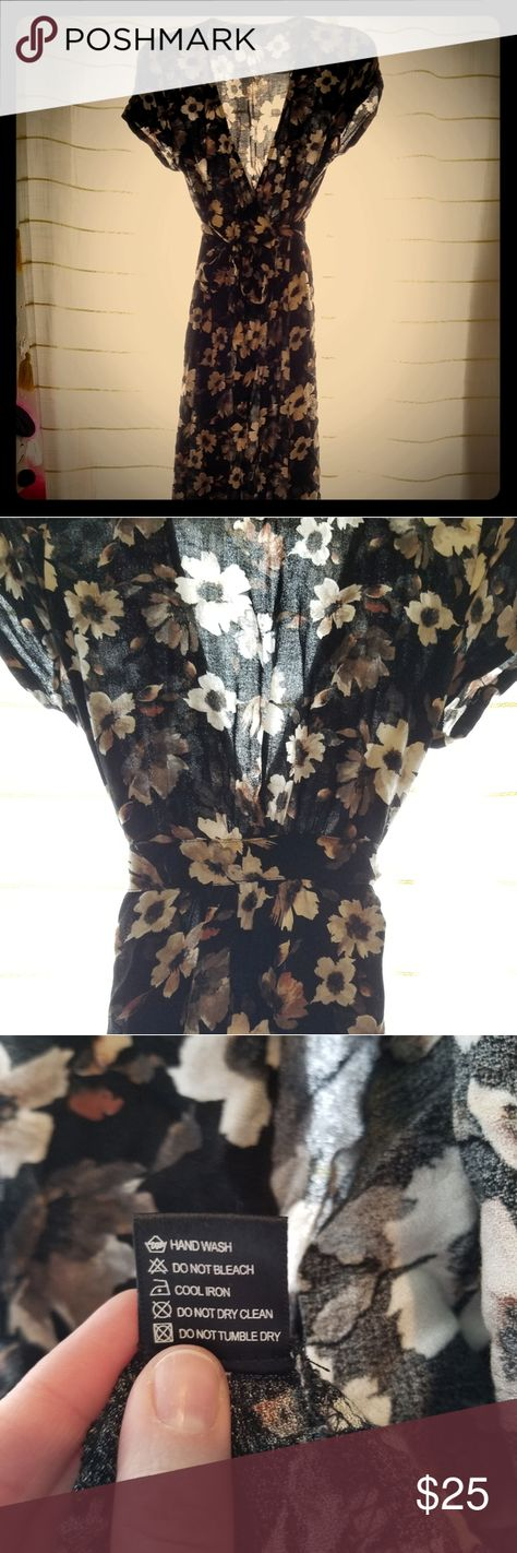 Short sleeved maxi floral wrap dress Olivaceous short sleeved wrap maxi dress. Black with white & light brown flower pattern. Inner tie & outer tie. Slightly sheer & unlined. I wore with a black full slip for extra coverage. 100% rayon. Olivaceous Dresses Maxi
