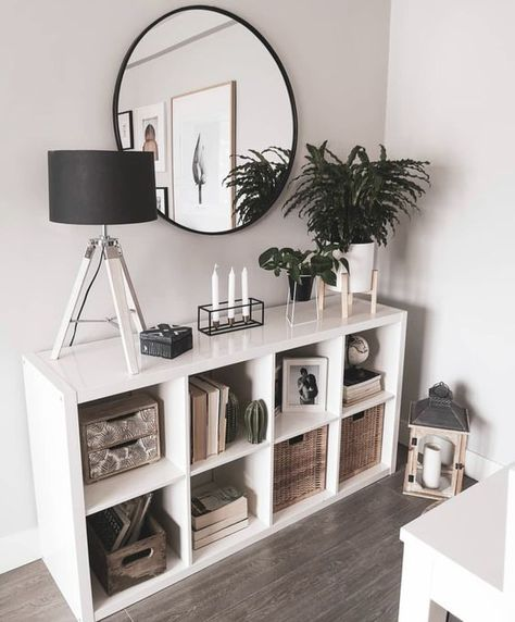 Standing or lying, against the wall or to divide the room – KALLAX series is eager to please and will adapt to your taste, space, budget and needs. Fine tune with drawers, shelves, boxes and inserts. Credit: Unknown