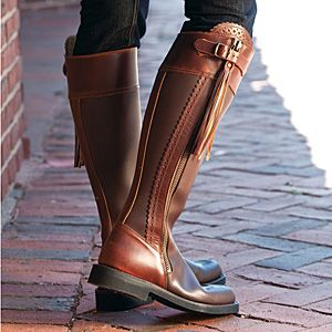 The Cordoba Andalusian Riding Boot is a beautifully styled two-tone brown calfskin leather boot. The heavy duty full-length zipper has a long leather fringe pull and single buckle closure for a unique and stylish look. Scalloped leather and intricate eyelets add to the character of these stunning boots.