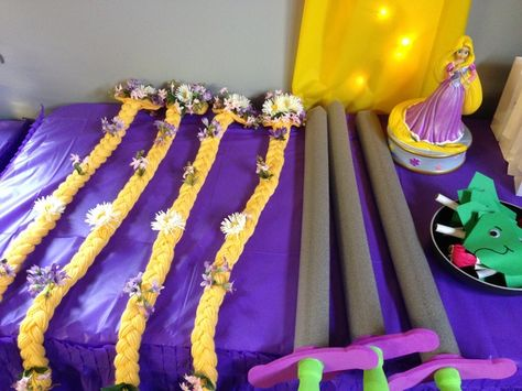 Braid hair clips and sword favors at a Tangled Party #tangled #partyfavors