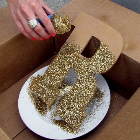Glitter letters are super easy, (a little messy) and totally worth the weeks of finding glitter afterwards.how to diy glitter for photo backdropGlitter In The Air Lyrics Product Golden Birthday, 50th Birthday Party, Diy 50th Birthday Decorations, Mascarade Party Decorations, 50th Anniversary Decorations, Birthday Centerpieces, Shower Centerpieces, 50th Wedding Anniversary, Anniversary Parties