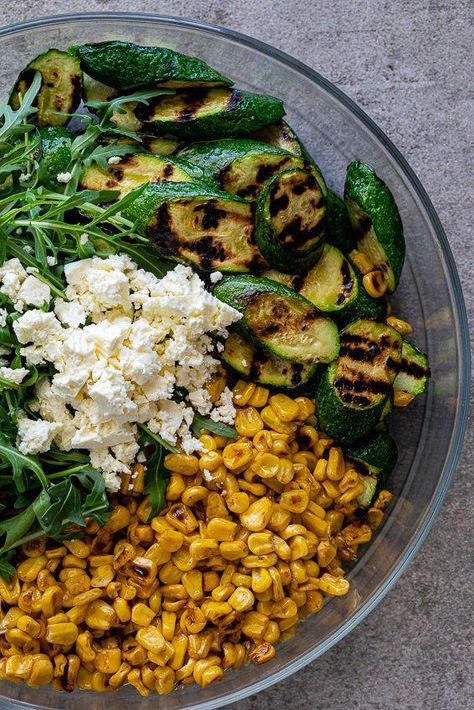 Easy grilled zucchini salad with charred corn, feta cheese and peppery arugula i. - Easy grilled zucchini salad with charred corn, feta cheese and peppery arugula is a delicious, glut - Veggie Recipes, Pasta Recipes, Cooking Recipes, Healthy Recipes, Healthy Salads, Summer Vegetarian Recipes, Summer Salad Recipes, Veggie Meals, Sausage Recipes