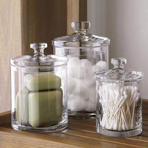 Set of 3 Glass Canisters Simple bathroom storage with a retro feel. Handmade glass canisters with nesting lids update a classic apothecary look. Handmade glass Cut and polished rim Hand wash for best results Made in multiple countries Bathroom Jars, Simple Bathroom, Bathroom Ideas, Bathroom Cabinets, Shower Ideas, Neutral Bathroom, Bathroom Makeovers, Bathroom Canvas, Bathroom Mirrors