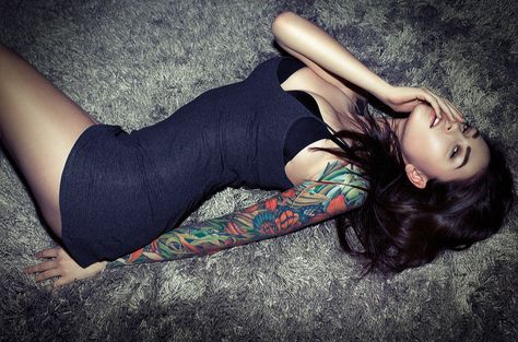 Sleeve tattoos/One sleeve only.