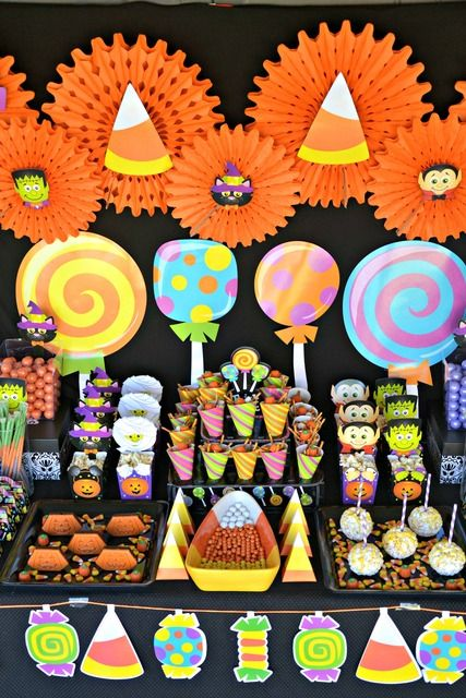 Beautiful candy-filled Halloween dessert table! See more party ideas at CatchMyParty.com.