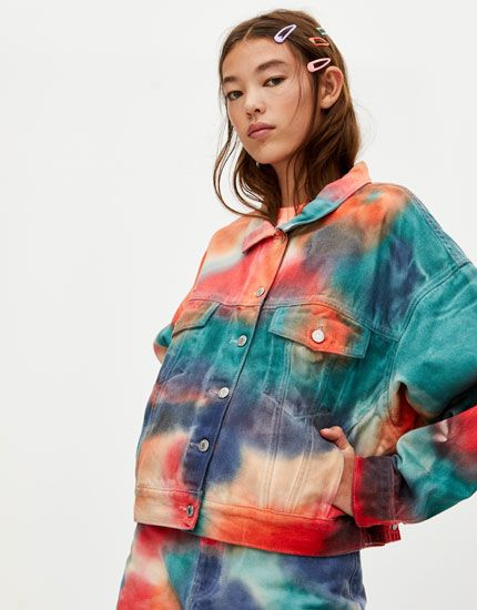 Multicoloured tie-dye denim jacket with pockets, contrast button fastening, long sleeves and a shirt collar.