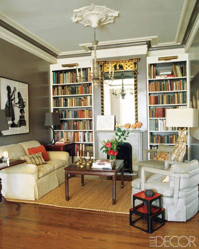"""Reviving a Victorian Home,"" via ""ELLE DECOR"" -- ""The living room features an 18th-century Chinese cocktail table, an ebonized Regency gilt mirror, and built-in shelves fitted with brass lights by Thomas O'Brien for Visual Comfort; a silhouette by Kara Walker hangs above the sofa, which is covered in a linen velvet by Cowtan & Tout."" -- Love this look!!"