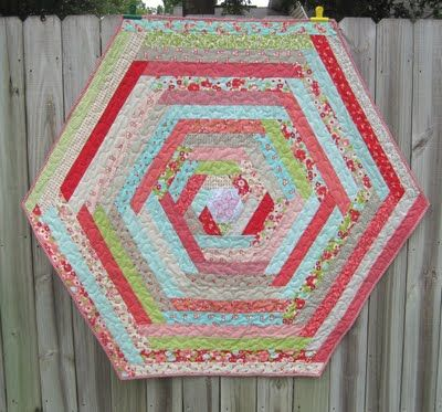 Hexagon-shaped Log Cabin