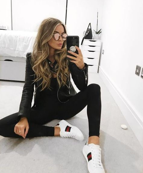 Cute black leather jacket over all black with comfy white sneakers. Cute black leather jacket over a