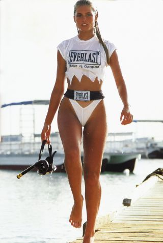 Kim Alexis in Bonaire on the Flamingo hotel dock for the 1984 Sports Illustrated Swimsuit Issue, photographed by Paolo Curto.