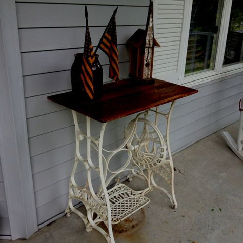 Old sewing machine frame, perfect table for my front porch.
