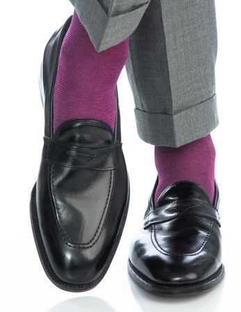 These fine men's dress socks are made with an exceptionally soft mercerized cotton. Expertly knitted at a third-generation North Carolina mill, these fashionable socks are a timeless addition to every