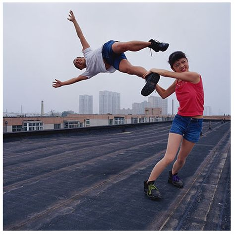 """""""Love at a high place"""", by Li Wei. Mixture of performance art and photography that creates illusions. Works with the help of props such as mirror, metal wires, scaffolding and acrobatics. No computer montages."""