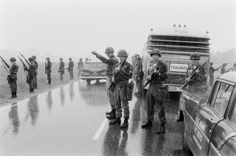 During a stop just short of the Mississippi line, Alabama Guardsmen surround a bus carrying the Freedom Riders on May 24, 1961.