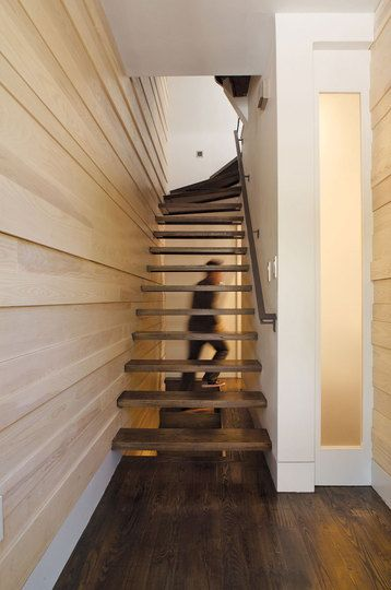 skinny stairs up to a third floor
