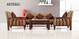 At Arterio We Indulge You In A Plush Ambiance Of Intricate Interiors And Flawless Furnitur Wooden Sofa Set Designs Sofa Set Designs Wooden Sofa Designs