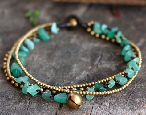 This anklet made with jade stones, brass beads, brass bell woven together with dark brown wax cord and brass bell for closure.  * Length is approx. 10