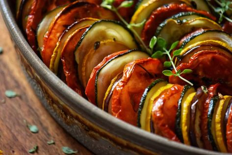 Here's an easy recipe to make the best Roasted Vegetables. A great recipe to use up those summer vegetables like eggplant, zucchini tomatoes, and red peppers. The addition of garlic transforms the dish into a taste sensation! #roastedvegetables #summersidedish #sidedish #ovenroasted