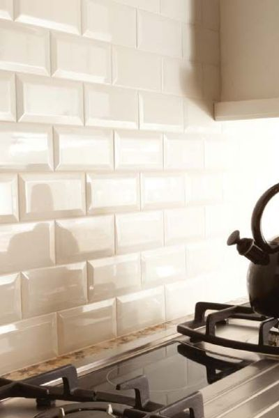 Bevelled Subway Tile Backsplash In A Kitchen Cream Or