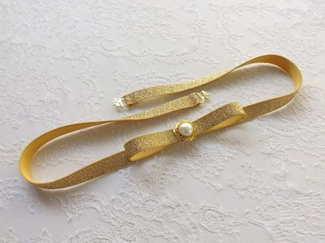 Gold glitter elastic bow belt. Sparkly waist belt. Pearly