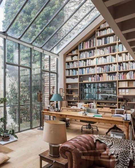 Beautiful home office with books and windows. Check out desigedecors.com to get