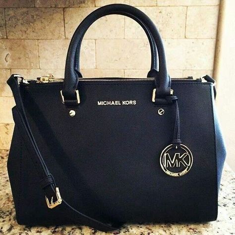 1b7ce566949 The perfect black MK purse