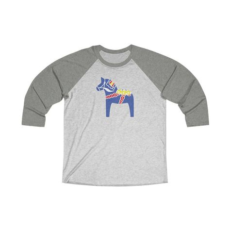 Our Traditional Dala Horse 3/4 raglan tee is a stylish spin on the classic baseball raglan. The combed cotton blend makes it super soft, comfortable, and lightweight. .: 50% Polyester 25% Soft cotton 25% Rayon.: Light fabric (4.3 oz/yd² (146 g/m²)).: Loose-fit.: Sewn in label XS S M L XL 2XL Width, in 17.49 19.02 20.52 22.01 24.02 26.03 Length, in 27.25 28.23 29.26 30.24 31.26 32.25 Sleeve length, in 23.43 24.02 24.61 25.2 25.79 26.38