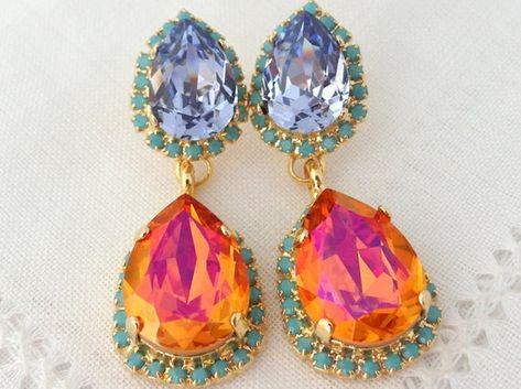 #weddings #jewelry #earrings #bridesmaidgift #bridalearrings #swarovskiearrings #chandelierearrings #statementearrings #dangleearrings #dropearrings #crystalearrings #rhinestoneearrings #bridalwedding #orangepink #orangeturquoise #purpleorange